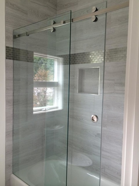 Barn style, frameless serenity, hydroslide shower doors.
